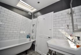 Renovated bathroom with skylight london